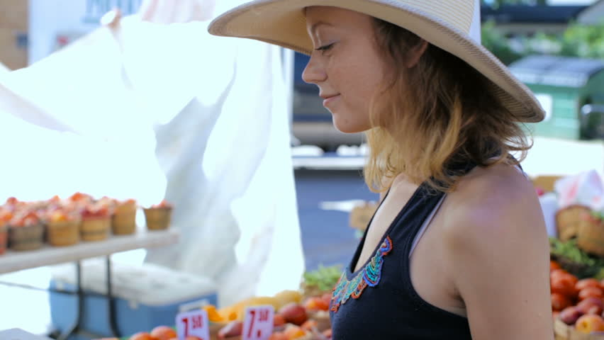 Young woman shopping at the local Farmers market. - HD stock video clip