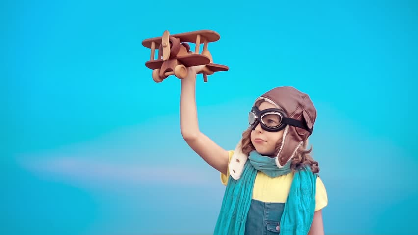 Happy kid with toy airplane. Child having fun outdoors. Kid playing in summer. Child against blue sky background. Travel and vacation concept. Imagination and freedom concept. Slow motion from 120 fps | Shutterstock HD Video #17464702