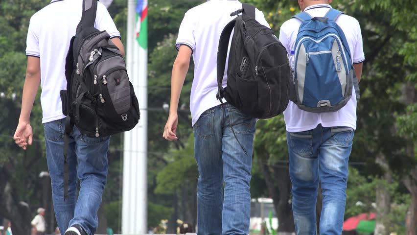 Students Wearing Backpacks Walking