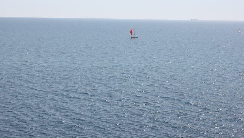 Sail boat in the distance sailing the sea stock footage for How much does a fishing license cost in texas