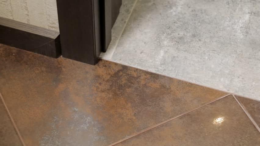 Smoke Under Door : Smoke seeps under door from a house fire stock footage