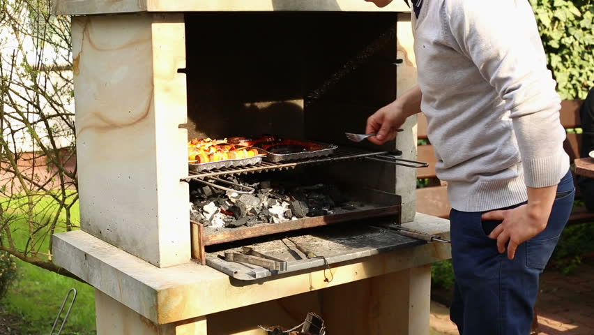 Men cooks a meat the grill  - HD stock video clip
