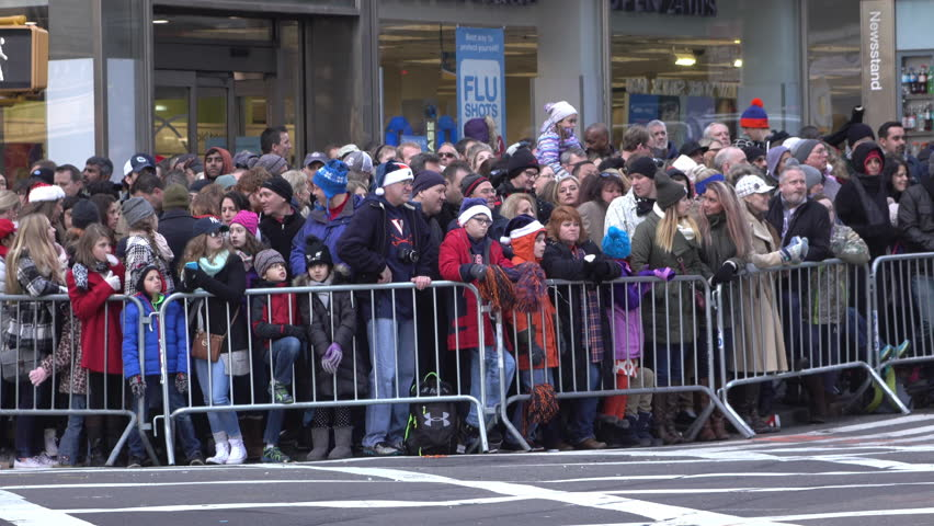 NEW YORK CITY, NY - NOVEMBER 26 : Waiting for 89th annual Macy's Parade, group of fans along route of Thanksgiving on November 26, 2015 in New York City, New York. - 4K stock footage clip