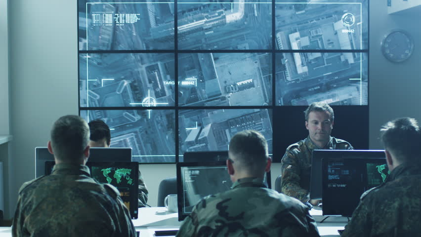 Group Of Military IT Professionals On Briefing In ...