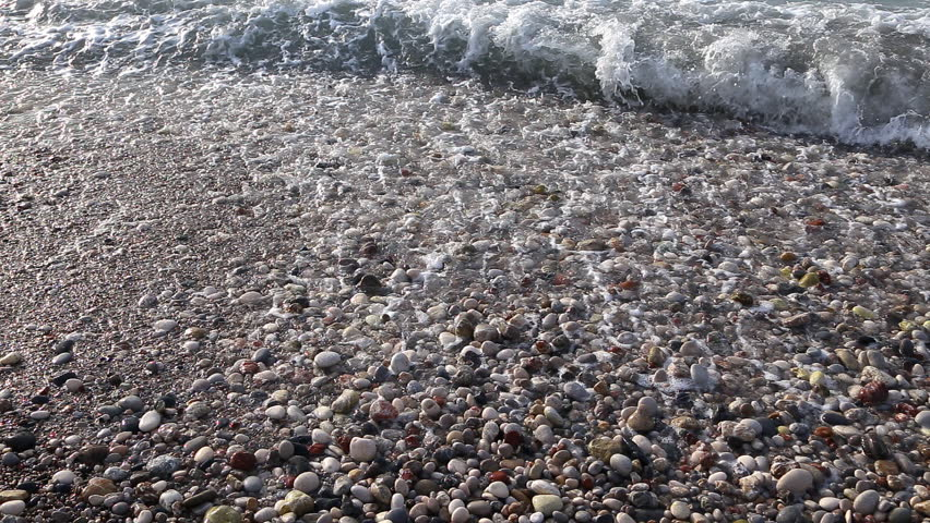 Sea surf. Waves runs on coastal pebble. - HD stock video clip