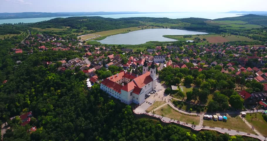 Aerial footage shows the Benedictine Abbey of Tihany overlooking the lake Balaton in Hungary. | Shutterstock HD Video #17640643