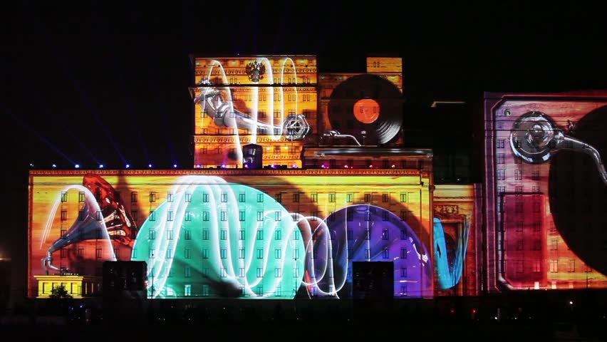 "MOSCOW, RUSSIA - OCTOBER 02, 2015: International Festival ""Circle of Light"". Laser video mapping show on facade of the Ministry of Defense in Moscow, Russia. 3D projection mapping on building 