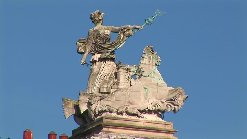 GUILDHALL ALFRED GELDER STREET HULL UK - CIRCA: 2009. Statue entitled Maritime Prowess by A.H. Hodge on the roof of building Courts of Justice displaying Aphrodite in a boat drawn by horses. Hull UK   - HD stock footage clip