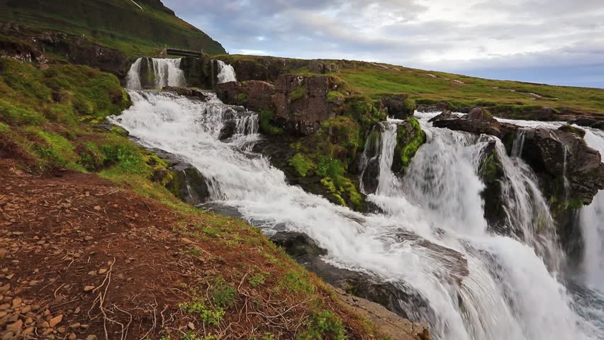 White nights view of Kirkjufellsfoss Waterfall and Kirkjufell mountain. Snaefellsnes peninsula, Iceland, Europe. Full HD video (High Definition).