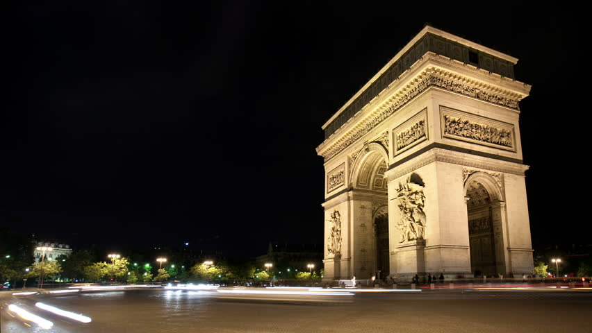 Timelapse at night Arc de Triomphe as traffic passes by
