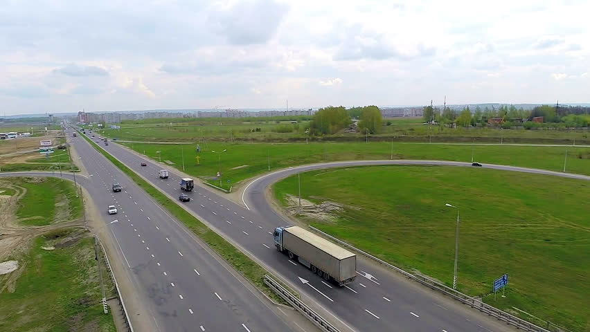 Aerial view of a truck and other traffic driving along a country road. | Shutterstock HD Video #17779126