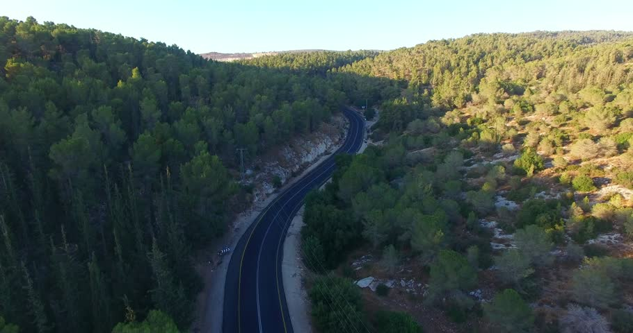 Aerial Road through mountains. Road in Forest zone.