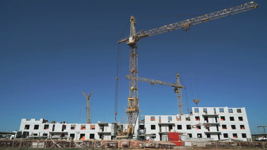 Three construction cranes working on the site - HD stock video clip