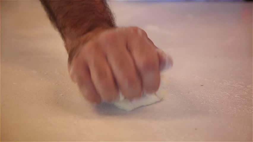 Chief knead the dough. Kneading, close up.