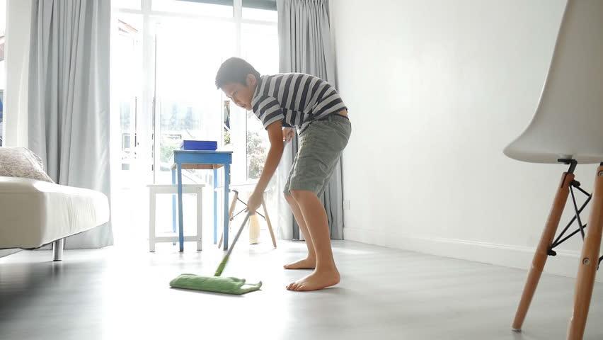A Man Using An Upright Vacuum Vacuums A Carpet Stock