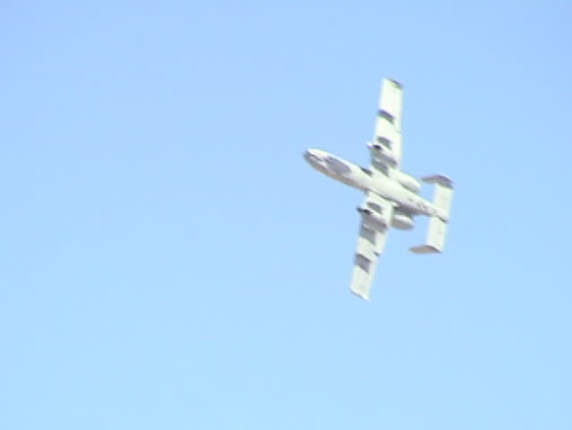 "Flyby of an A-10 ""Thunderbolt"" doing a 4-point roll. Reno AirShow, Nevada. - SD stock video clip"