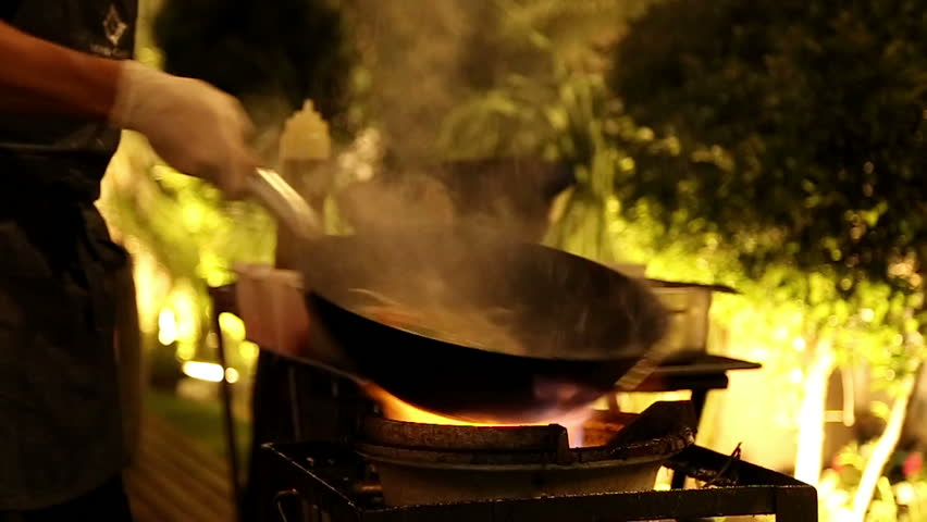 Professional stir fry in slow motion. Stir fry on gas.