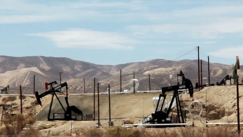 MARICOPA, CALIFORNIA - JULY 2014: Oil well pumps operating in the desert of California to help fuel America's growing need for petroleum products and promote our independence from foreign crude oil. - HD stock video clip