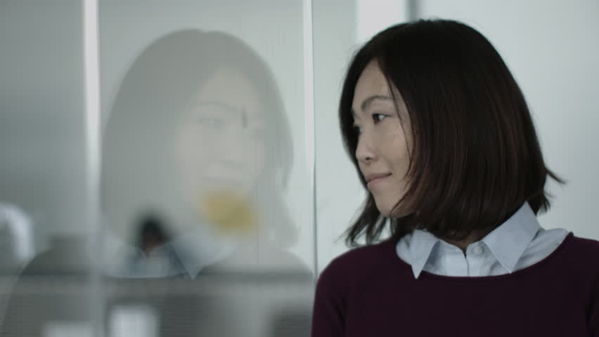 Portrait of Japanese business woman in office