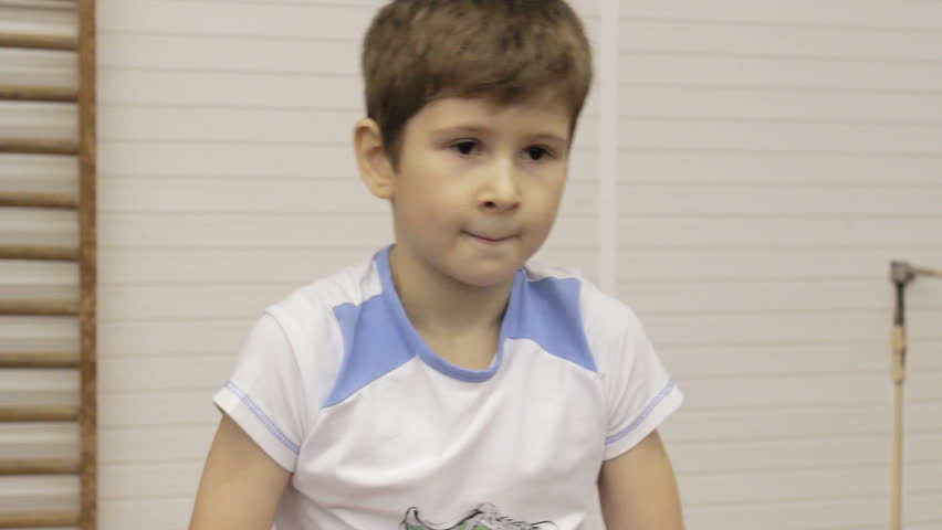 Young gymnast learn to perform gymnastic exercises | Shutterstock HD Video #18128191