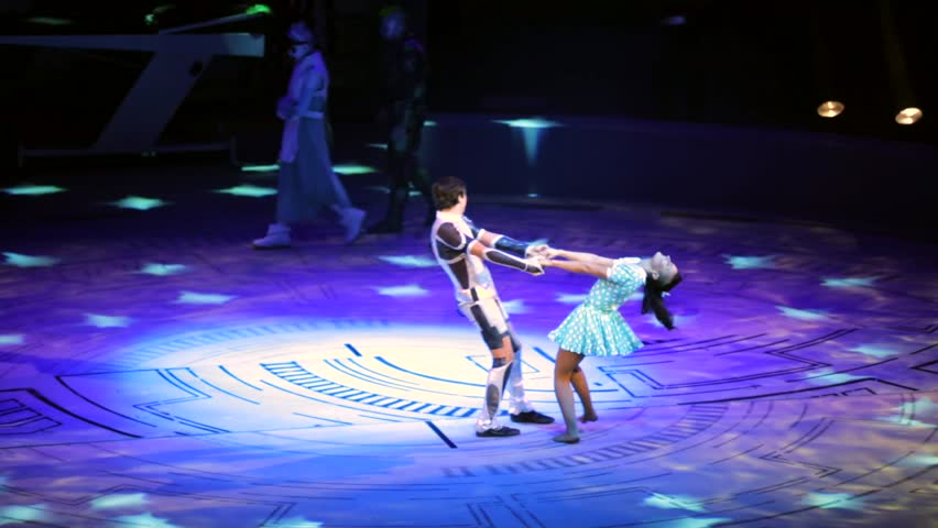 """ST. PETERSBURG, RUSSIA - JANUARY 2, 2016: Brothers Zapashny circus, """"UFO. Alien Planet Circus"""" show in Saint Petersburg. Man and woman dance in the middle of the stage when aliens appear"""