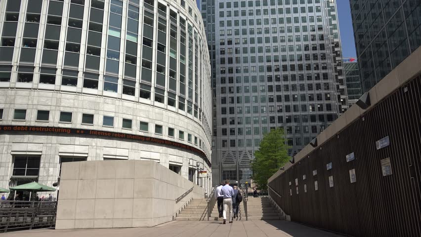 LONDON, JULY 17, 2016 4K Canary Wharf, London, Business People Walking in Financial District, Office - 4K stock footage clip