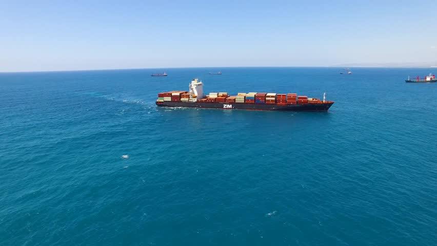 Haifa, Israel, July 19, 2016: Aerial footage of Zim Yokohama Container cargo ship at sea, loaded with containers, heading to her next port. | Shutterstock HD Video #18143086