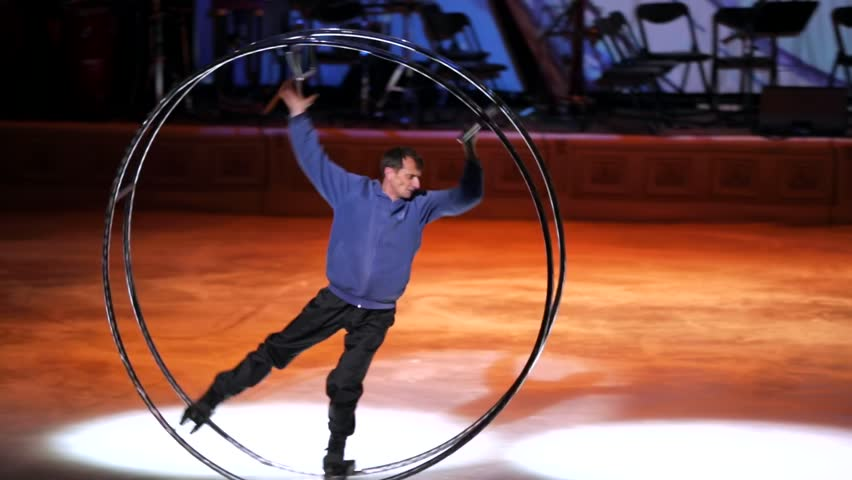 """MOSCOW, RUSSIA - JANUARY 12, 2016: Full rehearsal of theater of ice miniatures perfomance anniversary program """"We are 30"""" under direction of Igor Bobrin. Man in big wheel rolls on ice"""