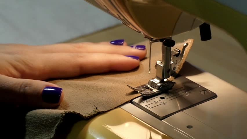 Hand Sewing On A Machine Stock Footage Video 1679116