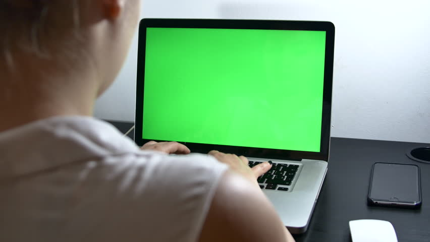 Young Assistant Working Hard At Her Laptop Early In The Morning, Green Screen, Over The Shoulder Shot | Shutterstock HD Video #18231286