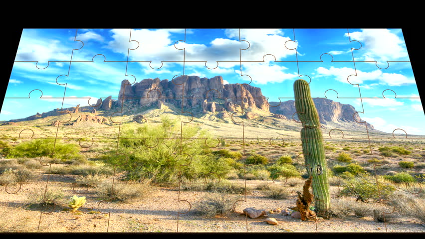 Dramatic time lapse of clouds passing over the Superstition Mountains in the Arizona desert forming randomly with jigsaw puzzle pieces. | Shutterstock HD Video #18238423