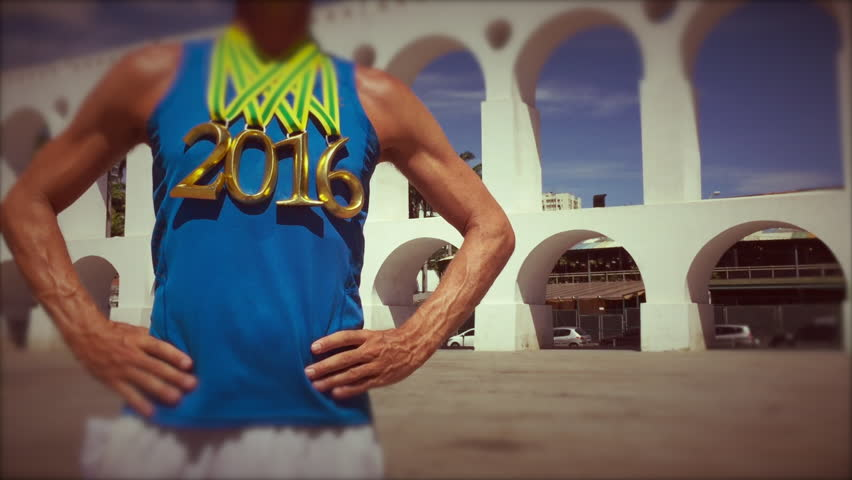 First place athlete wearing 2016 gold medals standing at Arcos da Lapa Arches in Rio de Janeiro, Brazil