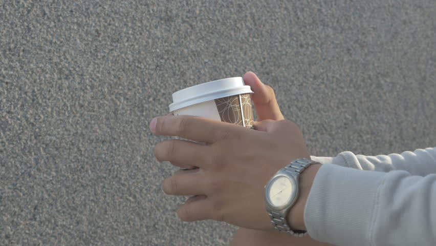 A young man on the street drinking coffee, coarsely porter | Shutterstock HD Video #18308038