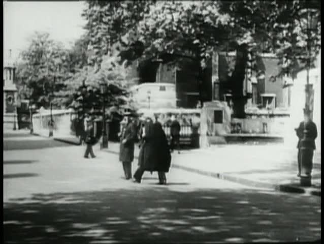 Wide shot pedestrians walking along city street