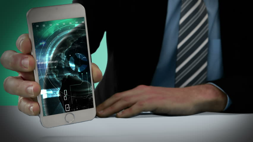 Hand of businessman showing mobile phone with virtual digital interface | Shutterstock HD Video #18359149