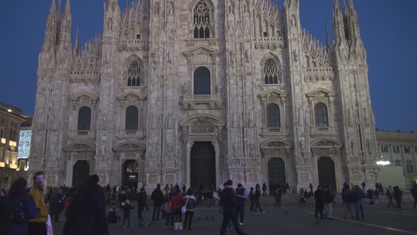 MILAN - DECEMBER 30: Unidentified people pass near to The Duomo Cathedral - HD stock footage clip