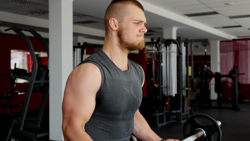 Sport bodybuilding young strong body man hard training muscles in gym | Shutterstock HD Video #18399523