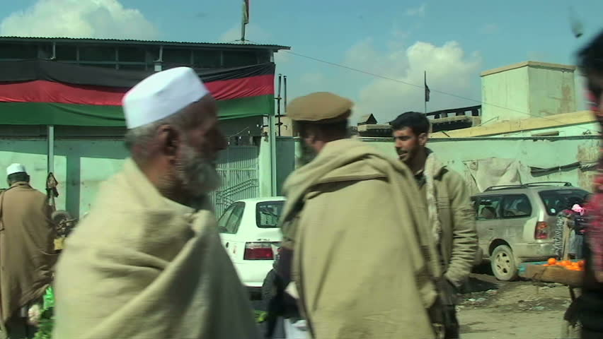 AFGHANISTAN - KABUL 2011 - Driving on the streets full of people in Kabul - HD stock footage clip
