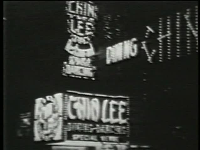 Montage - neon billboards, New York City, 1930s