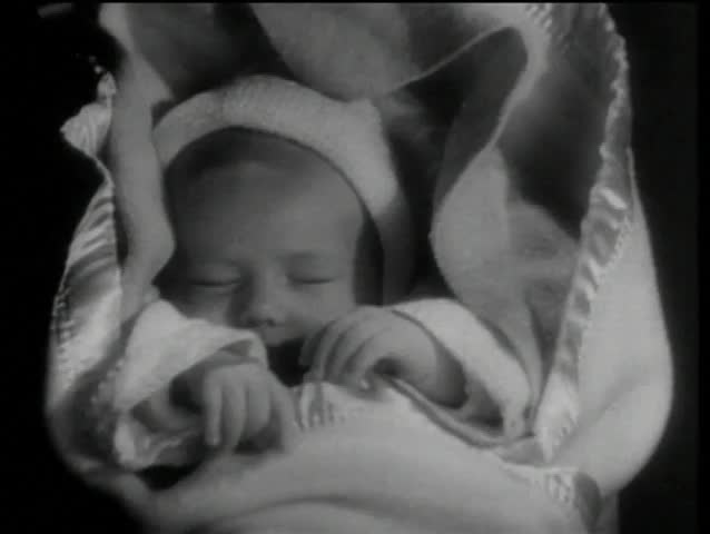 Close-up of sleeping infant wrapped in a blanket - SD stock video clip
