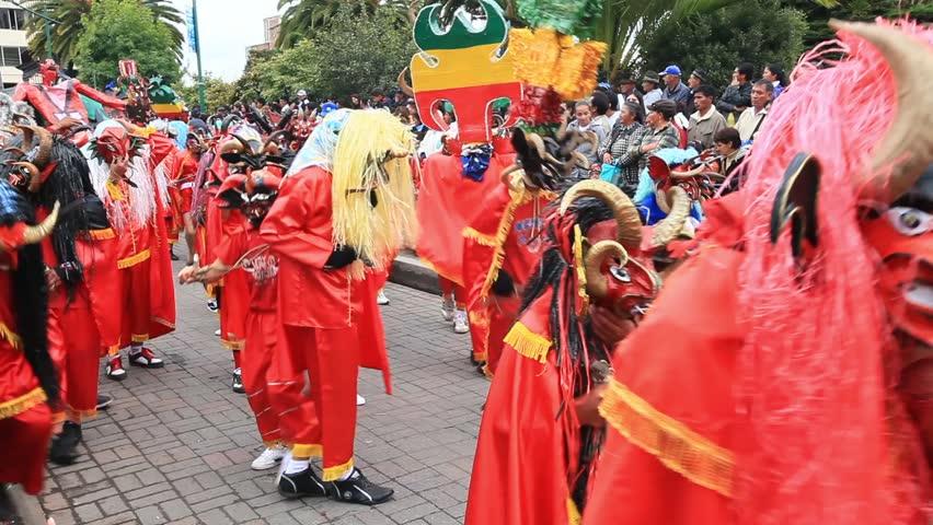 PILLARO, ECUADOR - JANUARY 6: Persons disguised as devils dance in the streets for Diablada de Pillaro, on January 6, 2011 in Pillaro, Ecuador. - HD stock footage clip
