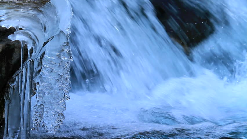 Rapid flow of water in a mountain river in winter.