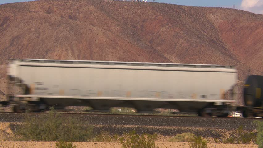 freight train passing in the desert - HD stock video clip