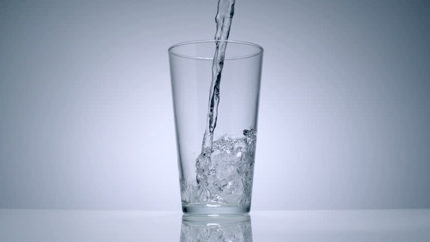 Slo-motion water poured in a glass - HD stock footage clip