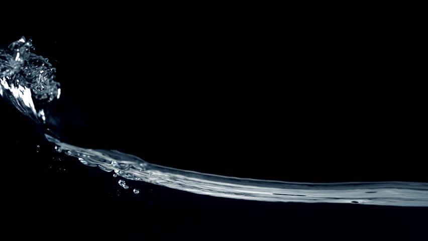 Slo-motion water  against black drop