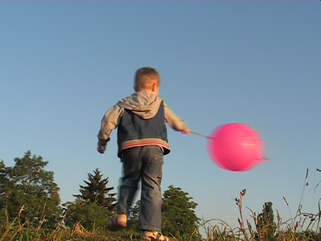 child play with red ball - SD stock footage clip