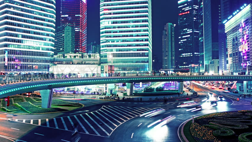 the light trails of city traffic on the modern building background in shanghai china. timelapse - HD stock video clip