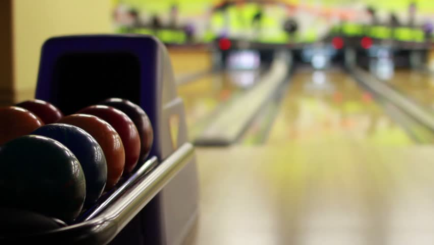 playing bowling in a bowling saloon
