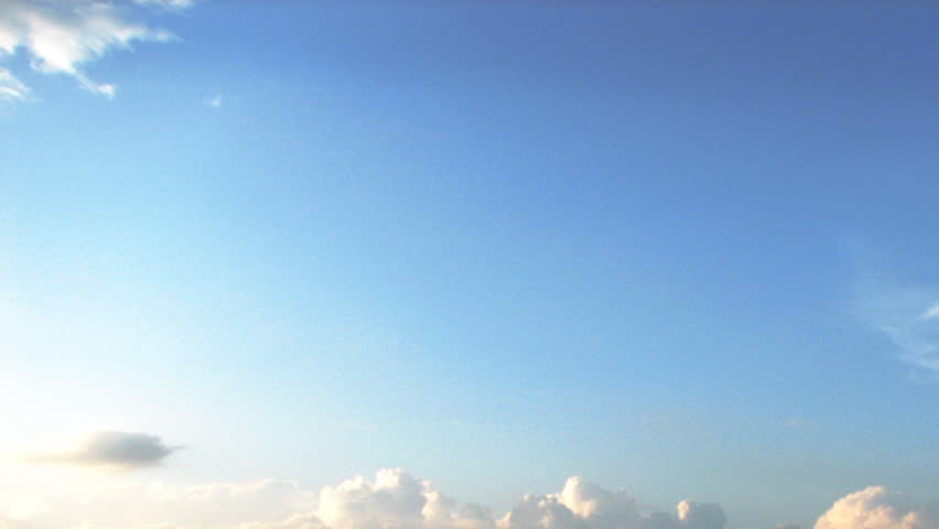 Time lapse of white clouds over blue sky - HD stock video clip