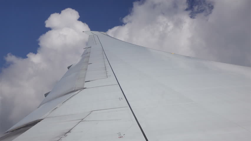 Aircraft wing on cloudscape and blue sky. #19164109